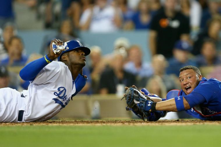 Yasiel Puig Avoids Getting Tagged Out at Home, Scores Run vs. Cubs