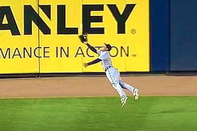 Tigers' Ezequiel Carrera Lays out for a Catch in Center Field vs. Yankees