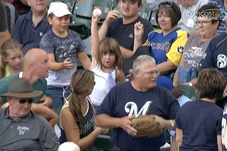 Young Girl Finds Foul Ball in a Crowd of People, Everyone Around Her Celebrates