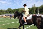 Notre Dame Coach Kelly Rolls Up to Practice on Horse