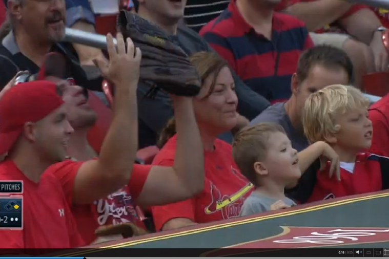 Young Fan Throws Ball Back onto Field at Cardinals Game