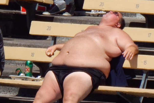 Shirtless Dodgers Fan Basks in the Glory of Afternoon Baseball