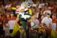Watch Baylor QB Bryce Petty Hurdle Defender for Se…