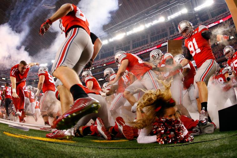 Ohio State Cheerleader Nearly Trampled as Players Run onto Field