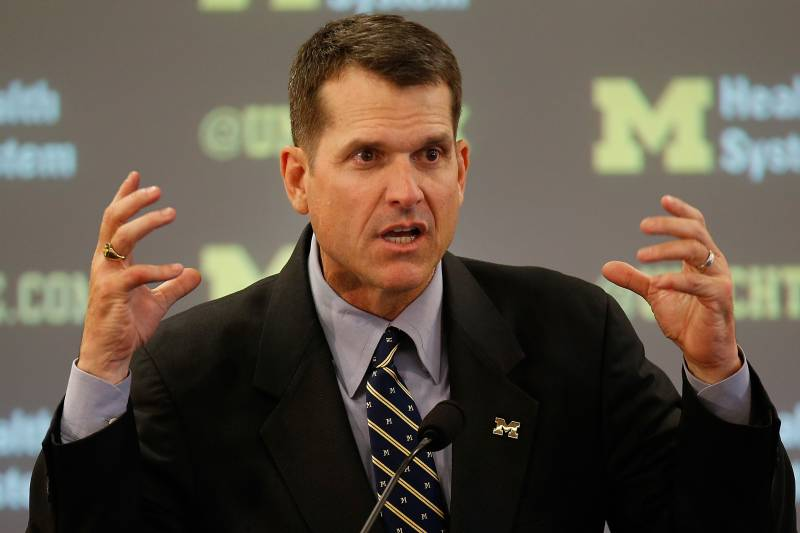 breaking down jim harbaugh s michigan contract and how he could