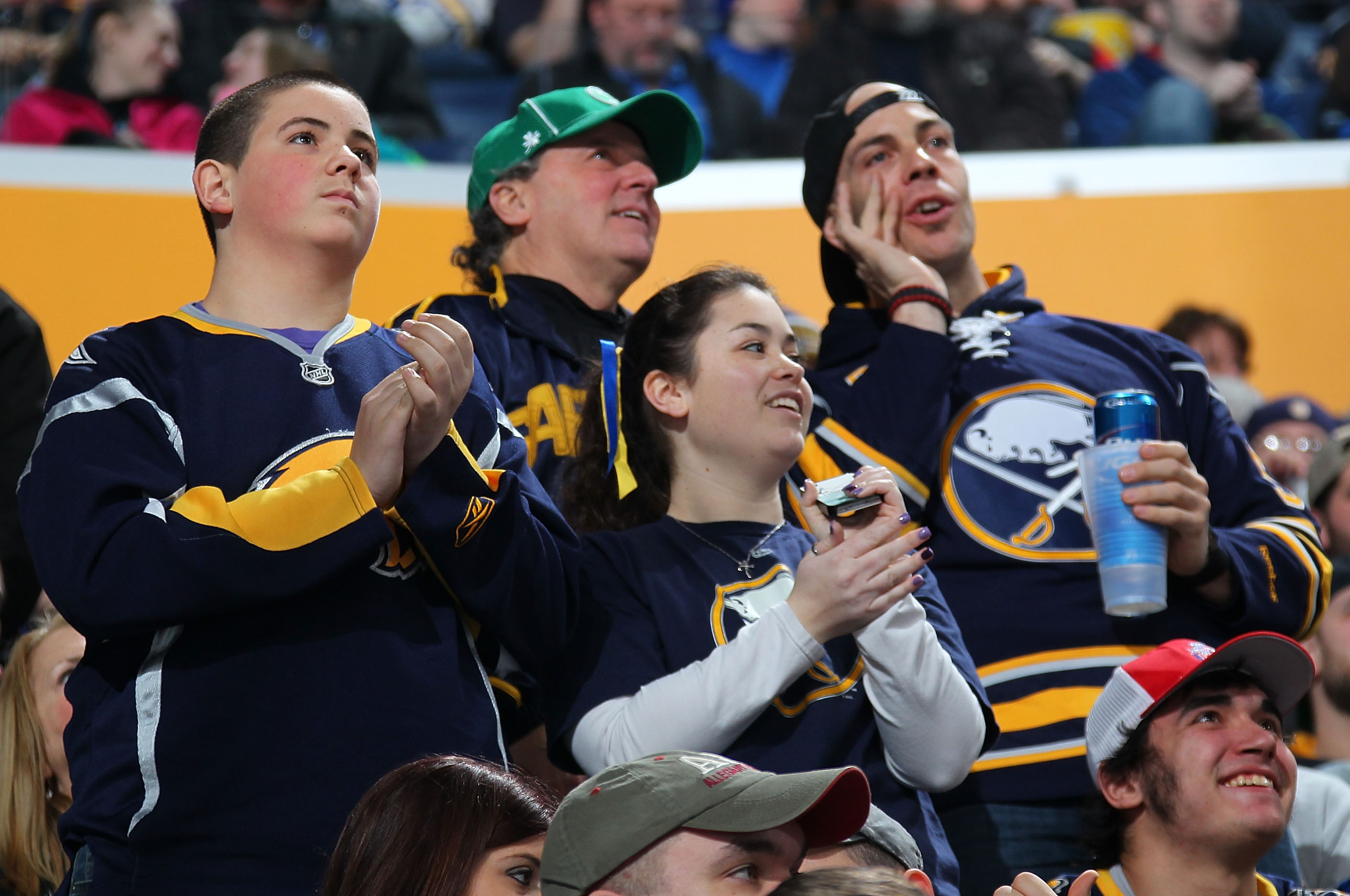 Chris Hajt signs autographs for Buffalo Sabres fans in ...