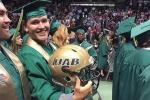 UAB Player Protests, Wears Helmet to Graduation