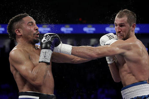 Sergey Kovalev, right, of Russia, throws a left at Andre Ward during their light heavyweight boxing match, Saturday, Nov. 19, 2016, in Las Vegas. (AP Photo/John Locher)