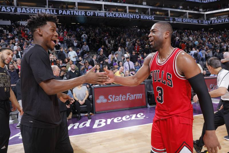 SACRAMENTO, CA - FEBRUARY 6: Jimmy Butler #21 and Dwyane Wade #3 of the Chicago Bulls high five during the game against the Sacramento Kings on February 6, 2017 at Golden 1 Center in Sacramento, California. NOTE TO USER: User expressly acknowledges and agrees that, by downloading and or using this photograph, User is consenting to the terms and conditions of the Getty Images Agreement. Mandatory Copyright Notice: Copyright 2017 NBAE (Photo by Rocky Widner/NBAE via Getty Images)
