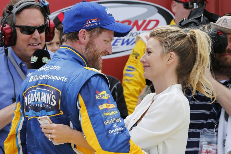 Dale Earnhardt Jr. ,left, gets a hug from his fiancee Amy Reimann as