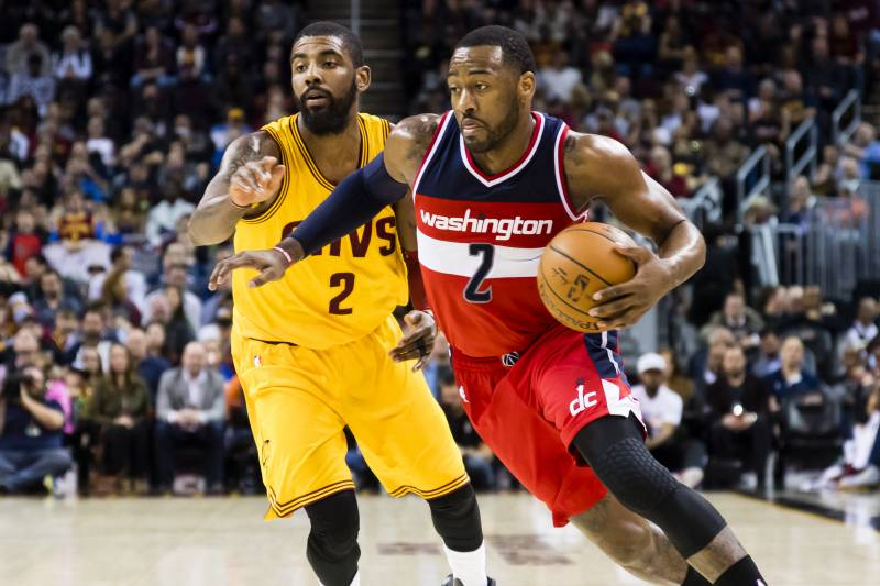 CLEVELAND, OH - MARCH 25: John Wall #2 of the Washington Wizards drives past Kyrie Irving #2 of the Cleveland Cavaliers during the first half at Quicken Loans Arena on March 25, 2017 in Cleveland, Ohio. NOTE TO USER: User expressly acknowledges and agrees that, by downloading and/or using this photograph, user is consenting to the terms and conditions of the Getty Images License Agreement. (Photo by Jason Miller/Getty Images)