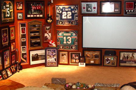 Man cave with sports memorabilia20 Garage Man Caves For Football Season   Home Matters. Sports Man Cave. Home Design Ideas