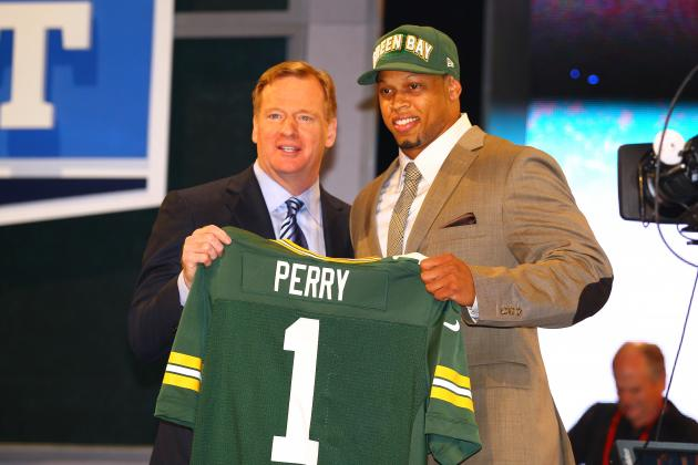 Who Are the Experts Predicting to Green Bay in the First Round of the NFL Draft?