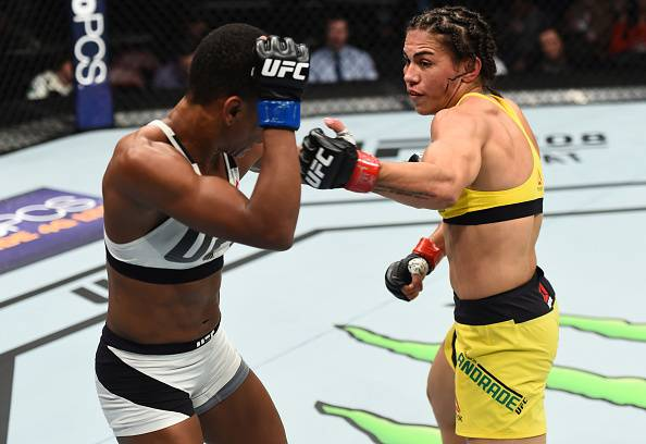 Jessica Andrade (right) moves forward with another barrage during her unanimous-decision victory over Angela Hill (left).
