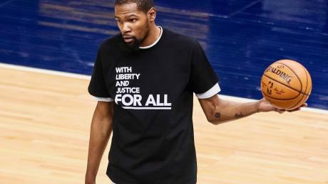 Nets, Wolves wear warm-up shirts in wake of shooting
