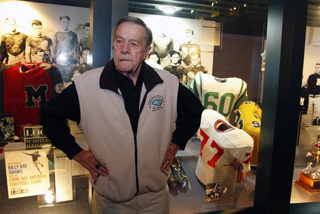 Larry Grantham with his No. 60 Jets jersey at the Mississippi Sports Hall of Fame.