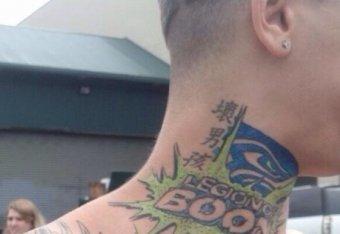 seattle fan has legion of boom tattoo of a seahawk trashing a
