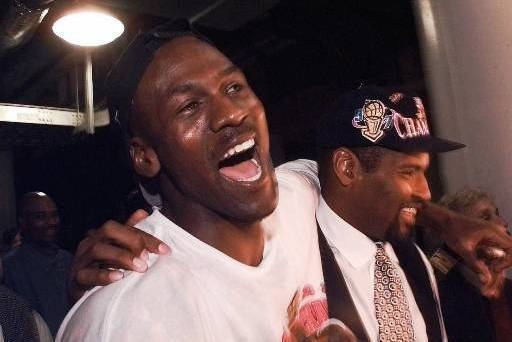 Jordan celebrates the Bulls' 1996-97 NBA Finals victory.