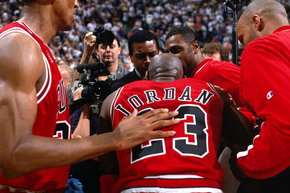Jordan surrounded by his teammates.