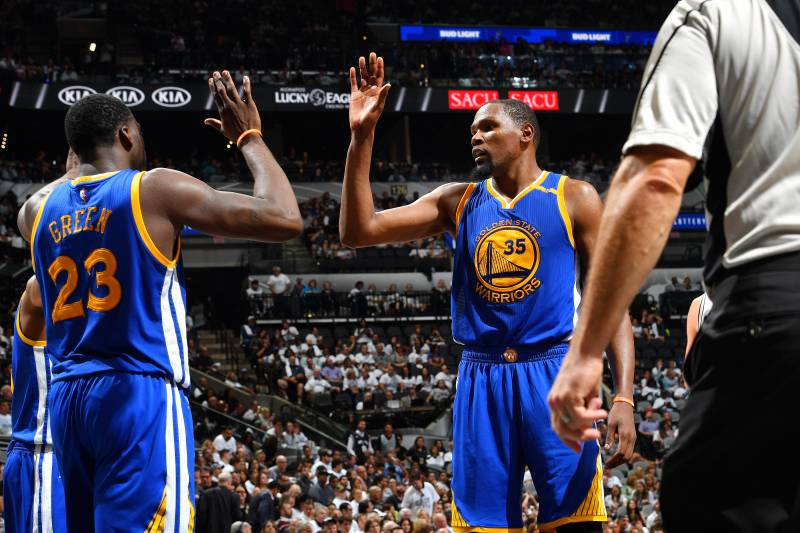 SAN ANTONIO, TX - MAY 20: Kevin Durant #35 and Draymond Green #23 of the Golden State Warriors high five each other during the game against the San Antonio Spurs during Game Three of the Western Conference Finals of the 2017 NBA Playoffs on May 20, 2017 a