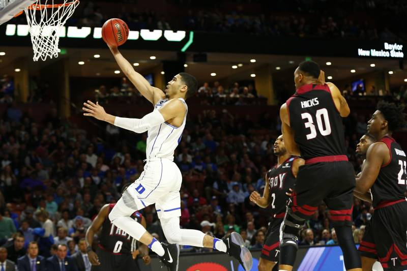 Mar 17, 2017; Greenville, SC, USA; Duke Blue Devils forward Jayson Tatum (0) shoots the ball against Troy Trojans forward Alex Hicks (30) during the second half in the first round of the 2017 NCAA Tournament at Bon Secours Wellness Arena. Mandatory Credit