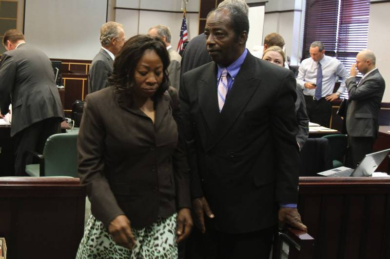 Ereck Plancher's parents, Gisele and Enock, leave the courtroom during the wrongful death trial of their son, who died in 2008 while a member of the University of Central Florida football team.