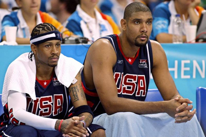Athens, Greece:  American team mate Allen Iverson (L) sits on the bench next to Timothy Duncan during their Olympic Games men's basketball semi final match against Argentina, 27 August 2004, at the Olympic Indoor Hall in Athens. AFP PHOTO/Donald EMMERT  (