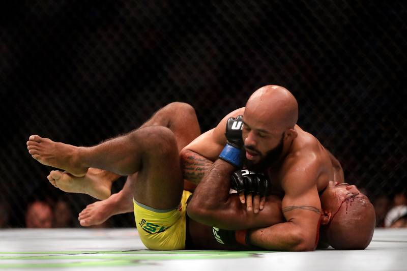 KANSAS CITY, MO - APRIL 15: Demetrious Johnson (top) takes down Wilson Reis (bottom) during their Flyweight Championship bout on UFC Fight Night at the Sprint Center on April 15, 2017 in Kansas City, Missouri. (Photo by Jamie Squire/Getty Images)