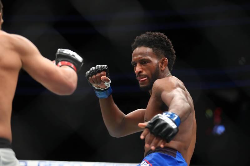 December 30, 2016; Las Vegas, NV, USA; Neil Magny moves in against Johny Hendricks during UFC 207 at T-Mobile Arena. Mandatory Credit: Mark J. Rebilas-USA TODAY Sports