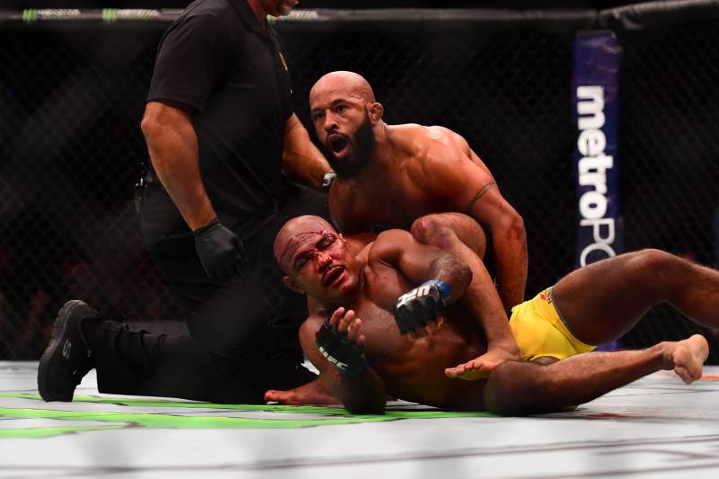Apr 15, 2017; Kansas City, MO, USA; Demetrious Johnson (red) wins the fight over Wilson Reis (blue) fight during UFC Fight Night at Sprint Center. Mandatory Credit: Ron Chenoy-USA TODAY Sports