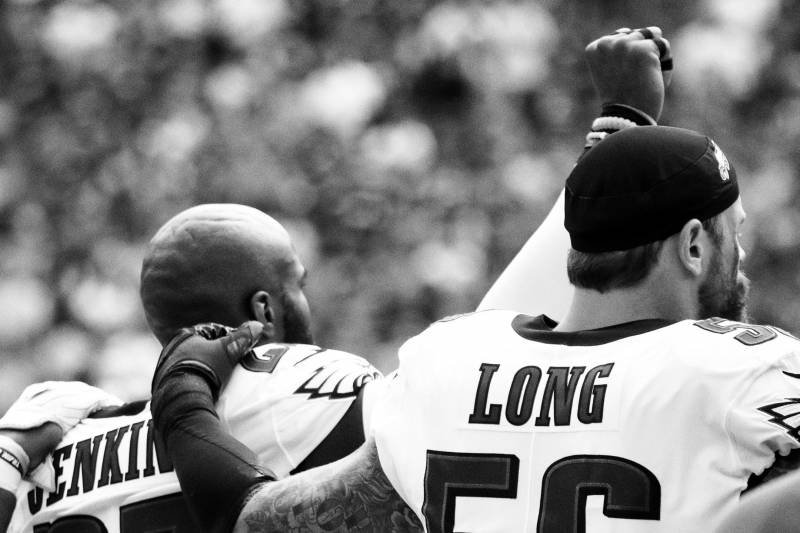 """One year after Colin's protest began, Chris Long of the Philadelphia Eagles joined his teammate Malcolm Jenkins during the national anthem. """"Part of being an activist,"""" says the head of the Ross Initiative in Sports for Equality, """"is being prepared to be attacked or disliked for taking a position—it involves risk."""""""