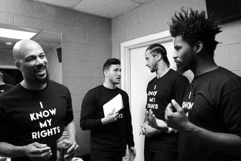 """Colin backstage with Common (left) and Ameer """"Left"""" Loggins (right) at the Know Your Rights Camp in Chicago, which Colin paid for out of his own pocket. """"Colin represents an inconvenience,"""" Loggins says."""