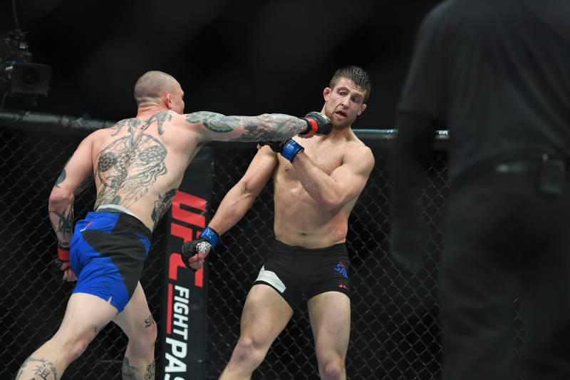 Smith (left) hits Andrew Sanchez during their fight in April.