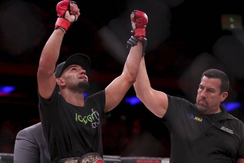 Douglas Lima celebrates a successful title defense against Lorenz Larkin.