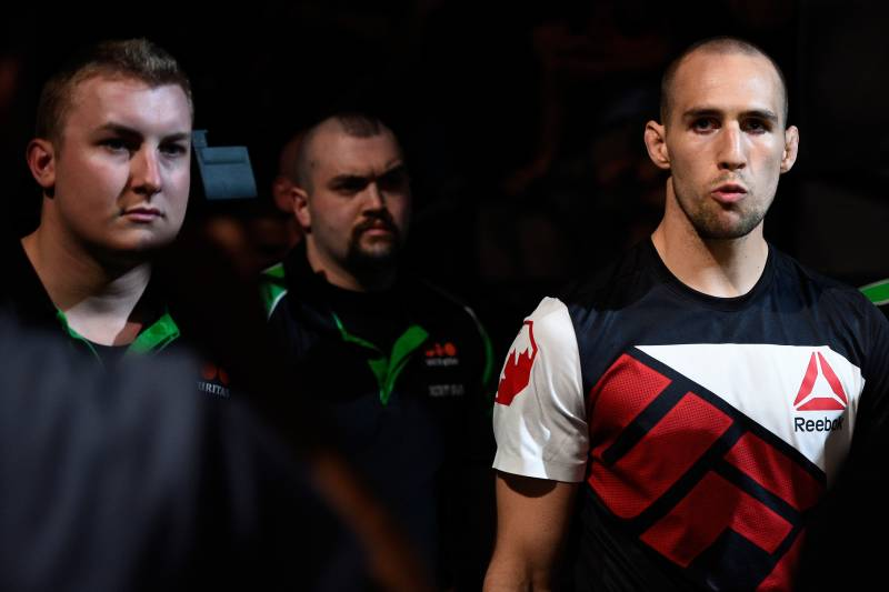 Rory MacDonald walks to the cage for his final UFC fight, against Stephen Thompson.
