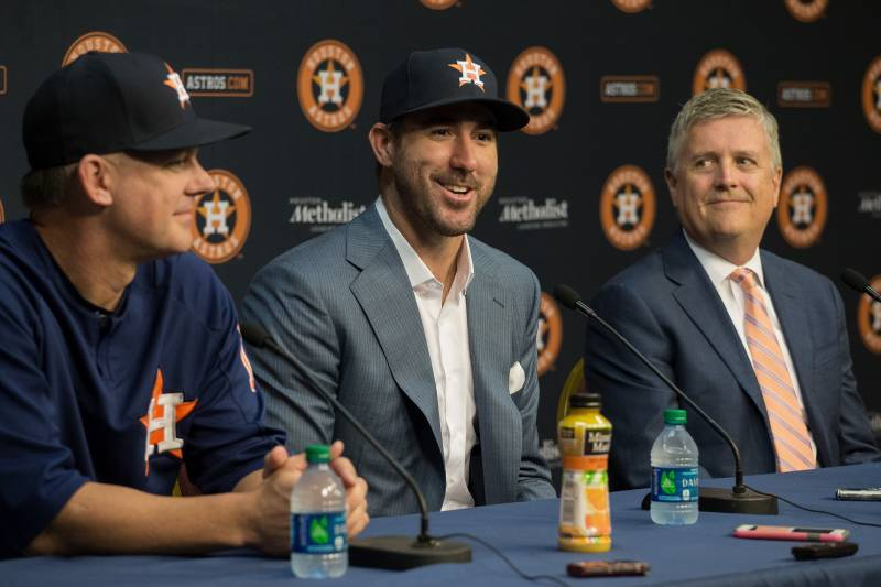 As the trade talks went on, Luhnow (right, with manager A.J. Hinch and Verlander) realized how much he wanted it to get done.