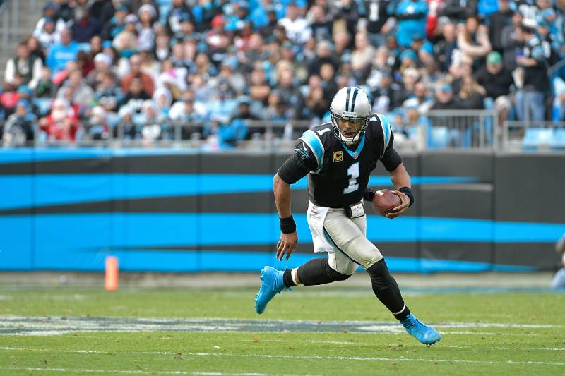 CHARLOTTE, NC - DECEMBER 24:  Cam Newton #1 of the Carolina Panthers runs against the Tampa Bay Buccaneers during their game at Bank of America Stadium on December 24, 2017 in Charlotte, North Carolina.  (Photo by Grant Halverson/Getty Images)