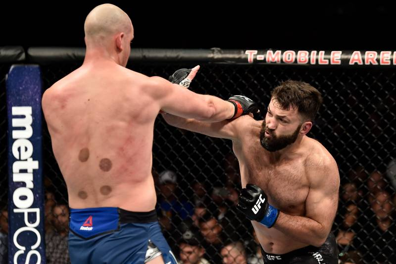 LAS VEGAS, NV - MARCH 03: (R-L) Andrei Arlovski of Belarus punches Stefan Struve of The Netherlands in their heavyweight bout during the UFC 222 event inside T-Mobile Arena on March 3, 2018 in Las Vegas, Nevada. (Photo by Jeff Bottari/Zuffa LLC/Zuffa LLC