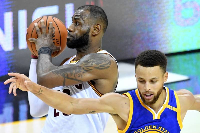 CLEVELAND, OH - JUNE 09: LeBron James #23 of the Cleveland Cavaliers handles the ball against Stephen Curry #30 of the Golden State Warriors in the fourth quarter in Game 4 of the 2017 NBA Finals at Quicken Loans Arena on June 9, 2017 in Cleveland, Ohio.