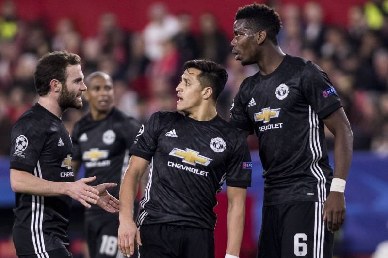 SEVILLE, SPAIN - FEBRUARY 21:  ALEXIS SANCHEZ (C ), JUAN MATA (L ) and PAUL POGBA (R ) argue after missing a chance at goal during the UEFA Champions League Round of 16 First Leg match between Sevilla FC and Manchester United at Estadio Ramon Sanchez Pizj