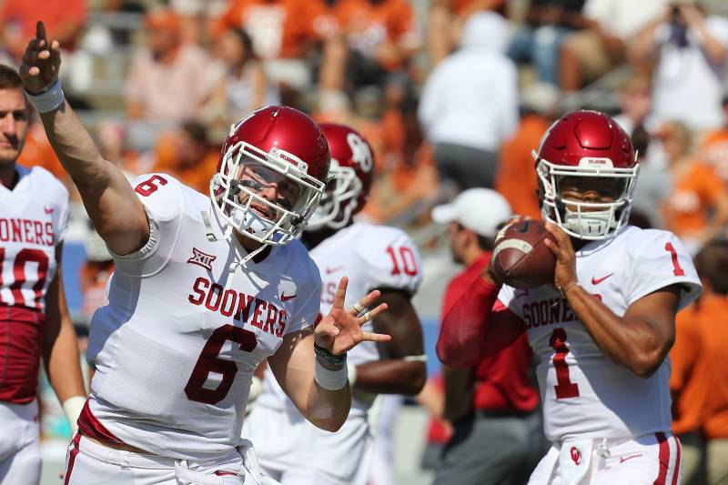 DALLAS, TX - OCTOBER 14:  Baker Mayfield #6 of the Oklahoma Sooners and Kyler Murray #1 of the Oklahoma Sooners warm up before the game against the Texas Longhorns at Cotton Bowl on October 14, 2017 in Dallas, Texas.  (Photo by Richard Rodriguez/Getty Ima