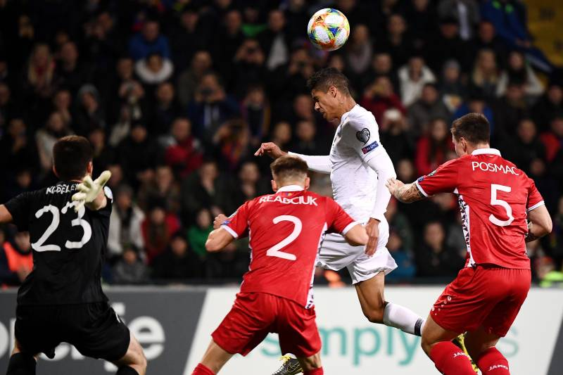 France's defender Raphael Varane (2ndR) scores a goal during the Euro 2020 qualifying football match between Moldova and France, on March 22, 2019 at Zimbru stadium in Chisinau. (Photo by FRANCK FIFE / AFP)        (Photo credit should read FRANCK FIFE/AFP