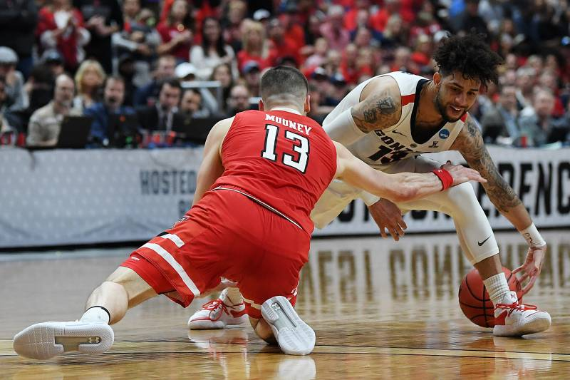 ANAHEIM, CALIFORNIA - MARCH 30: Josh Perkins #13 of the Gonzaga Bulldogs loses the ball against Matt Mooney #13 of the Texas Tech Red Raiders during the first half of the 2019 NCAA Men's Basketball Tournament West Regional at Honda Center on March 30, 201
