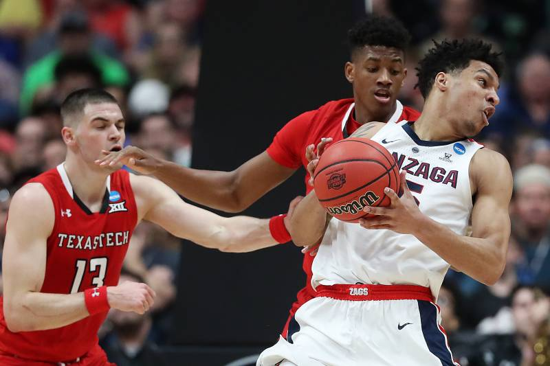 ANAHEIM, CALIFORNIA - MARCH 30: Brandon Clarke #15 of the Gonzaga Bulldogs posts up against Jarrett Culver #23 of the Texas Tech Red Raiders during the first half of the 2019 NCAA Men's Basketball Tournament West Regional at Honda Center on March 30, 2019
