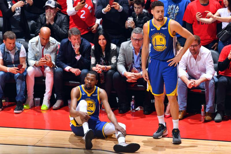 TORONTO, CANADA - JUNE 10: Kevin Durant #35 of the Golden State Warriors reacts to his leg injury during a game against the Toronto Raptors during Game Five of the NBA Finals on June 10, 2019 at Scotiabank Arena in Toronto, Ontario, Canada. NOTE TO USER