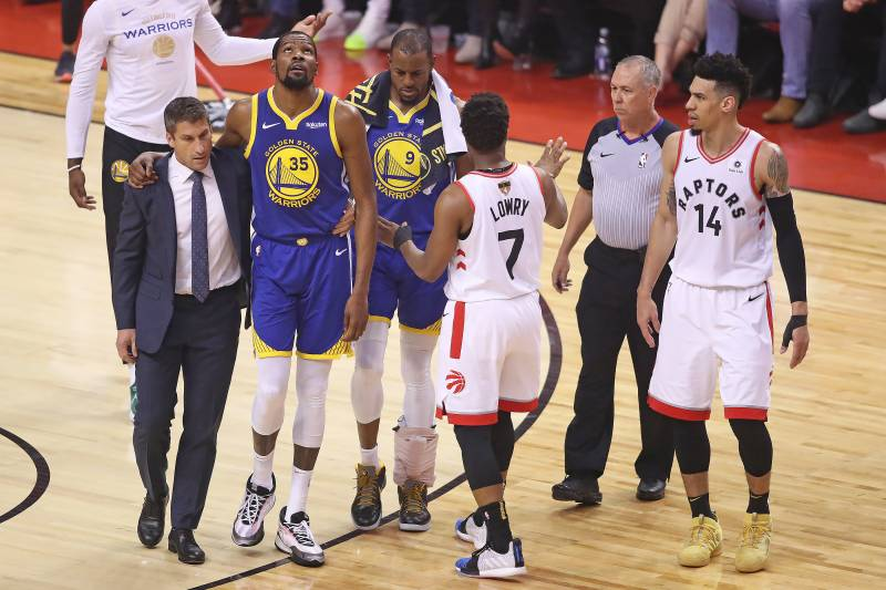 TORONTO,ONTARIO - JUNE 10:  Kyle Lowry #7 of the Toronto Raptors tries to get the crowd to show their respect for an injured Kevin Durant #35 of the Golden State Warriors during Game Five of the 2019 NBA Finals at Scotiabank Arena on June 10, 2019 in Toro