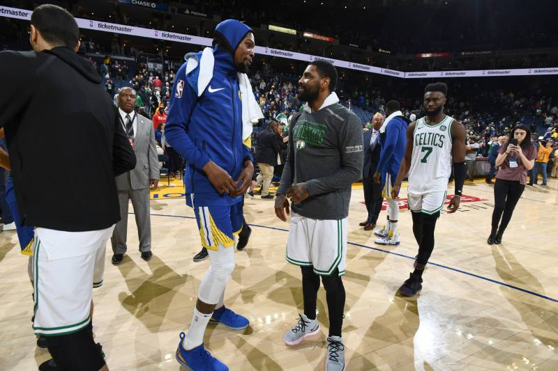OAKLAND, CA - MARCH 5: Kevin Durant #35 of the Golden State Warriors talks with Kyrie Irving #11 of the Boston Celtics after the game on March 5, 2019 at ORACLE Arena in Oakland, California. NOTE TO USER: User expressly acknowledges and agrees that, by do