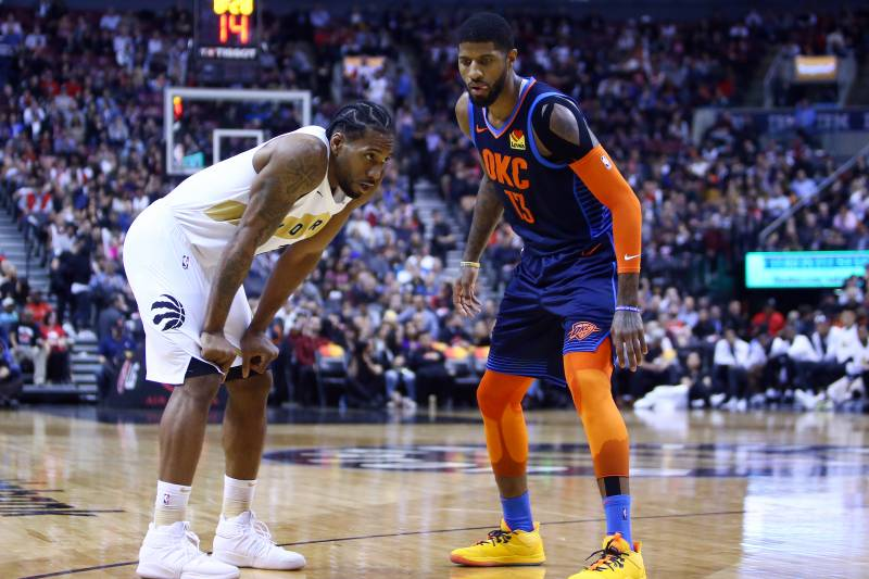 TORONTO, ON - MARCH 22:  Kawhi Leonard #2 of the Toronto Raptors and Paul George #13 of the Oklahoma City Thunder prepare for play to resume during the second half of an NBA game at Scotiabank Arena on March 22, 2019 in Toronto, Canada. NOTE TO USER: Use