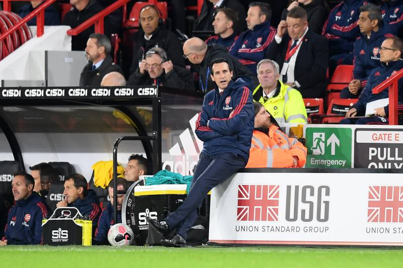 SHEFFIELD, ENGLAND - OCTOBER 21:   Unai Emery, Manager of Arsenal sits on an advertising board on the sideline during the Premier League match between Sheffield United and Arsenal FC at Bramall Lane on October 21, 2019 in Sheffield, United Kingdom. (Photo