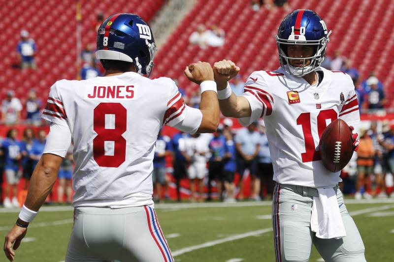TAMPA, FLORIDA - SEPTEMBER 22: Quarterbacks Daniel Jones #8 and Eli Manning #10 of the New York Giants fist bump during warmups before the game against the Tampa Bay Buccaneers at Raymond James Stadium on September 22, 2019 in Tampa, Florida. (Photo by Mi